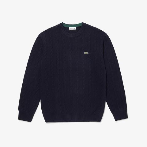 ケーブル編みニットセーター